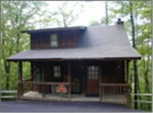 Twin Mountains Hideaway Cabin, Twin Mountain Log Cabins, Pigeon Forge — All One Room Hide-away Cabin sleeps 2 people max