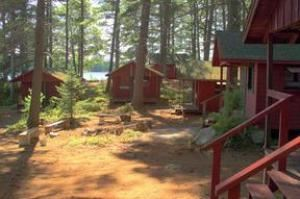 Entire Facility, Kingsley Pines, Raymond — Private cabins are located along the lake or nestled among our great pines. Most or our cabins have their own private bathrooms. Cabins without bathrooms share modern bathhouses. All cabins have electricity.