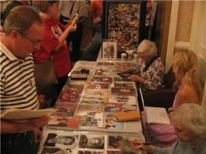 Mid Atlantic Nostalgia Convention, Hunt Valley — Fans collect autographs from celebrities Lee Meriwether and Celeste Holm.
