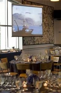 Harbor View Cafe, New England Aquarium, Boston — The ocean-blue tile and natural wood cathedral ceilings make the Harbor View Cafe the perfect setting for a rehearsal dinner or  intimate wedding reception.  The floor-to-ceiling windows offer spectacular views of the city skyline and Boston Harbor.