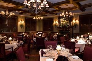 Mahogany Room, Jag's Steak & Seafood / Piano Bar, West Chester — The Mahogany's room capacity is 48 ppl. Deep rich mahogany woodwork hugs you in this room, the fireplace and electronic built in screen add a very nice touch. This room also adjoins to our outside patio and opens to our Florida room with french doors if needed for additional room. Very popular for meetings, rehearsal dinners and private parties.