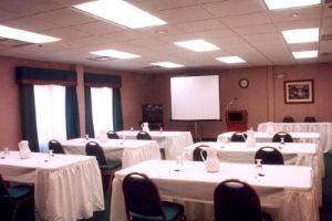 Conference Room, Holiday Inn Express & Suites Jacksonville-South, Jacksonville — Our meeting room comes with free flip charts, projection screen, and an overhead projector.