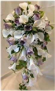 WeddingBouquets - Fayetteville, Fayetteville — This silk bridal bouquet is designed with: calla lilies, rose buds, ivy, beads and ribbons.