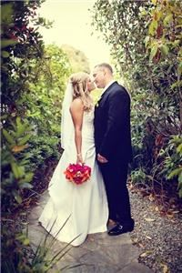 Jolynne Photography, Hemet — Bride and Groom in a hiding place