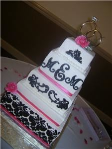 Delectable Delights By Debbie, Amherst  Buttercream cake with fondant accents. Real ribbon.