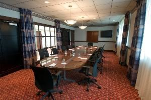 Executive Boardroom B, Hilton Cincinnati Airport, Florence — Each Executive Boardroom has a pull-down screen and can accommodate up to 12 people.