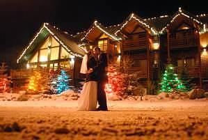 A Bear & Bison Canadian Country Inn, Canmore — We can customise your dream wedding. This picture is of a couple enjoying an evening winter wedding dream. Take a look at our website to see examples of our wedding packages