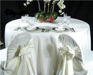 CHAIR COVERS & SASHES DELIVERED AND INSTALLED, Exotic Caterers, Brooklyn — White or Ivory chair covers with white or ivory sash