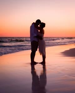 Photocraft By Tom Warriner, Destin — A beautiful sunset beach wedding by the Gulf of Mexico in Destin, Florida.