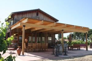 Cedar View Winery, Sanger — Cedar View Winery's patio is surrounded by its estate vineyard. The patio faces east and has views of the local and Sierra Nevada mountains. The patio can seat up to 90 people for a dinner. The winery's indoor cellar room can seat approximately 50 people.