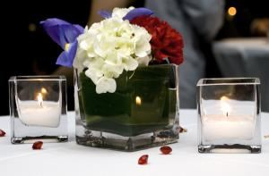 Joan Day Weddings, LLC, Columbia — The simple combination of a white hydrangea bloom, with an iris, and red carnation, created a lovely center piece adorning each cocktail table at a US Diplomatic reception.  Decor and catering direction, coordinated by Joan Day Kelley.