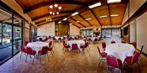 Chuckwagon, T Bar M Resort Hotel & Conference Center, New Braunfels — A soaring ceiling and expansive glass walls give the Chuckwagon a dramatic look that is rustic, yet elegant. A large fireplace complements the view. There are three well-appointed breakout rooms attached to the Chuckwagon, two of which can be entered from the outside. A 1,240 sq. ft. patio offers plenty of outdoor seating, while a large new playscape provides a safe, supervised environment for the kids to enjoy.