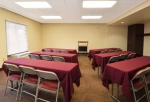 Conference Room, Red Roof Inn San Antonio Downtown Riverwalk, San Antonio — 600 sq feet.  Screen/whiteboard/podium included. In room coffee available complimentary. Maximum capacity Theatre Style,50 people. Classroom style,32 people. Additional a/v available. Please contact for pricing.