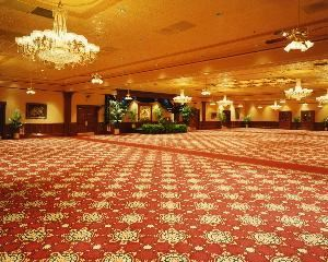 The Presidential Ballroom, The Ballroom at Church Street, Orlando — The entire Ballroom can fit upto 600 people for a sit down banquet.  The ceiling stained glass window, crystal chandeliers and authentic tin ceilings make this the perfect setting for an elegant dinner; awards banquet; or large corporate breakfast or luncheon.